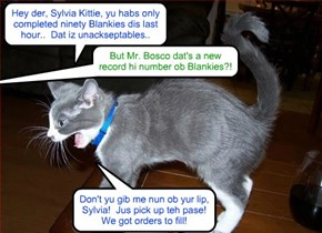 Bosco, who habs been promoted by Production Chief Mr. AllThumbs, shows how he iz helpin' Mr. AllThumbs supervise Sylvia Kittie..
