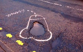 Street Art of the Day: Wanksy Draws Penises on Potholes to Force the City to Fix Them