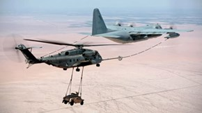 That's a Plane Refueling a Helicopter That's Carrying a Humvee. Because AMERICA.
