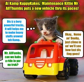Mr. AllThumbs checks owt a new truck at Kamp..