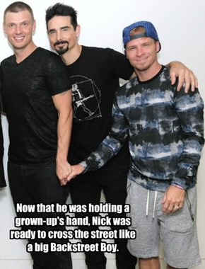 Now that he was holding a grown-up's hand, Nick was ready to cross the street like a big Backstreet Boy.