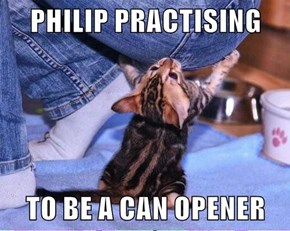 PHILIP PRACTISING  TO BE A CAN OPENER