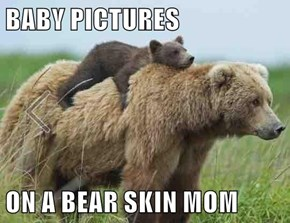 BABY PICTURES  ON A BEAR SKIN MOM