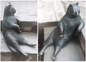 Classic Lounging Cat Gets Immortalized With a Statue
