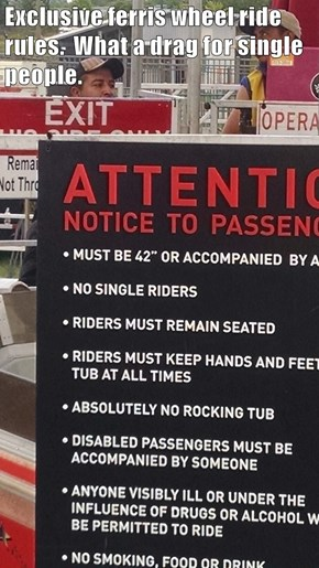 Exclusive ferris wheel ride rules.  What a drag for single people.