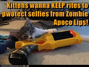 Kittehs wanna KEEP rites to pwotect selfies from Zombie Apoco Lips!