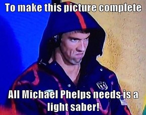 To make this picture complete  All Michael Phelps needs is a light saber!