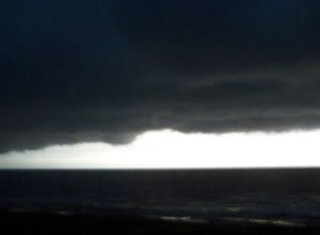 This is a storm cloud that just formed over the ocean outside my window