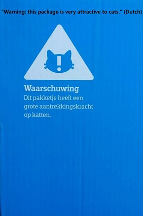 """""""Warning: this package is very attractive to cats."""" (Dutch)"""