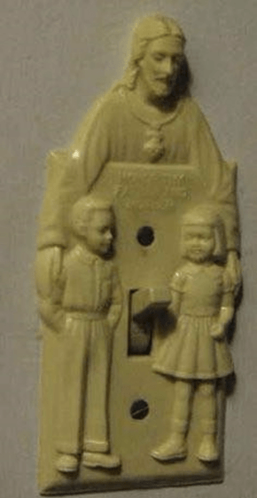 I'm sure this light switch cover designer meant well.