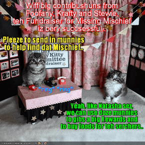 Natasha and Kandi man teh fones for teh fundraiser for munnies to find teh missing Mischief..