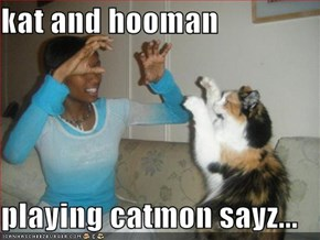kat and hooman  playing catmon sayz...