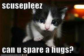 scusepleez   can u spare a hugs?
