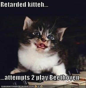 Retarded kitteh...  ...attempts 2 play Beethoven