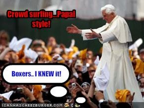 Crowd surfing...Papal style!