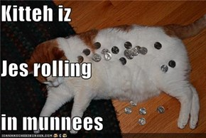 Kitteh iz Jes rolling in munnees