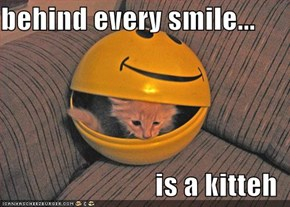 behind every smile...  is a kitteh