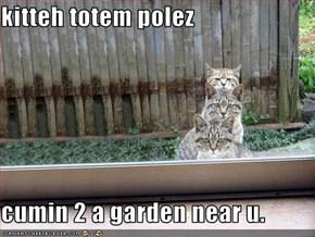 kitteh totem polez  cumin 2 a garden near u.