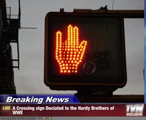 Breaking News - A Crossing sign Deciated to the Hardy Brothers of WWE