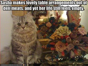 Sasha makes lovely table arrangements out of