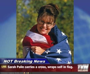NOT Breaking News - Sarah Palin carries a cross, wraps self in flag.
