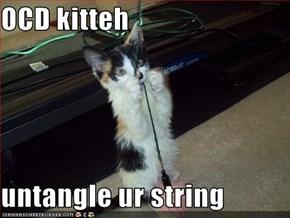 OCD kitteh  untangle ur string