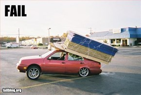 Hauling wood on car Fail