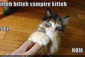 itteh bitteh vampire kitteh sez NOM