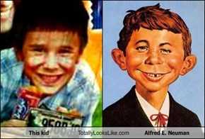 This kid Totally Looks Like Alfred E. Neuman