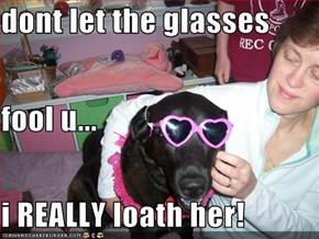 dont let the glasses fool u... i REALLY loath her!