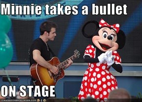 Minnie takes a bullet  ON STAGE