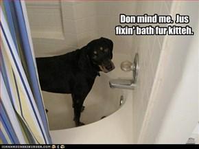 Don mind me.  Jus fixin' bath fur kitteh.