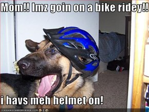 Mom!! Imz goin on a bike ridey!!  i havs meh helmet on!