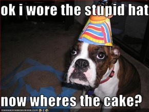 ok i wore the stupid hat  now wheres the cake?