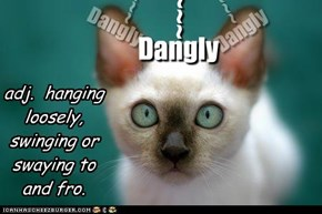 Dangly - adj - hanging loosely, swinging or swaying to and fro.
