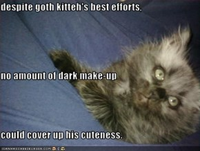 despite goth kitteh's best efforts, no amount of dark make-up  could cover up his cuteness.