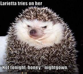 """Larietta tries on her  """"Not tonight, honey,"""" nightgown."""