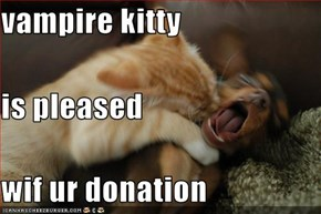 vampire kitty is pleased  wif ur donation