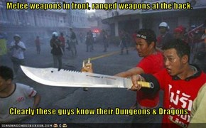 Melee weapons in front, ranged weapons at the back.  Clearly these guys know their Dungeons & Dragons.