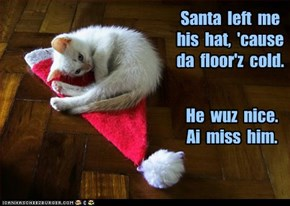 Santa  left  me  his  hat,  'cause  da  floor'z  cold.