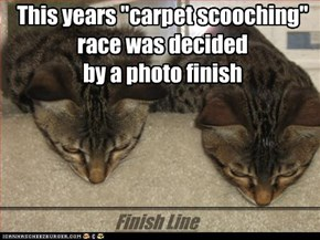"This years ""carpet scooching"" race was decided  by a photo finish"