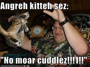 "Angreh kitteh sez:  ""No moar cuddlez!!!1!!"""