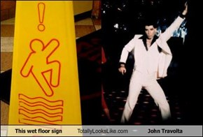 This wet floor sign Totally Looks Like John Travolta
