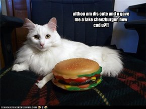 although am dis cute and gave me a fake cheezburger, how cud u?!!