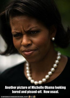 Another picture of Michelle Obama looking bored and pissed-off.  How unusual.