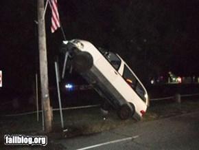 Van stuck on guy-wire