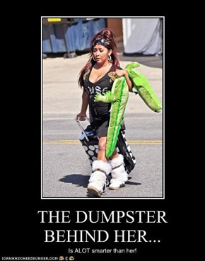 THE DUMPSTER BEHIND HER...