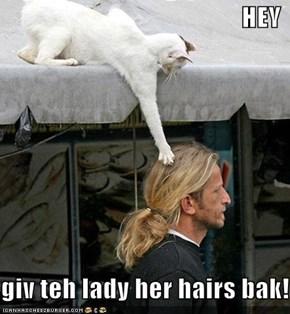 HEY  giv teh lady her hairs bak!