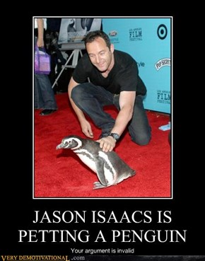 JASON ISAACS IS PETTING A PENGUIN