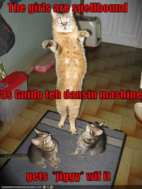 The girls are spellbound  as Guido teh dansin mashine gets  *jiggy* wif it